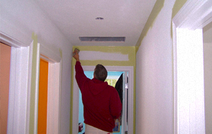 Man drilling a hole in a ceiling